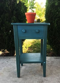 blue wooden 2-drawer end table