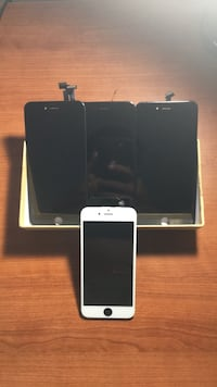 silver iPhone 6 and black iPhone 5 New Orleans