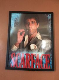Scarface movie poster in frame.