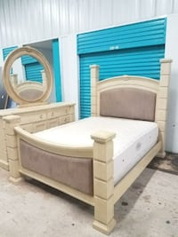 quilted white mattress and brown wooden bed frame Greenacres
