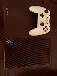 white Xbox One console with controller Austin