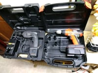 two orange and grey cordless hand drills