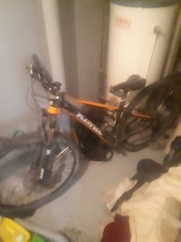 black and red full-suspension mountain bike Red Deer, T4N 0S2