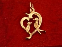 Sterling sail we 24kt gold plated love birds pendant