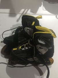 Pair of black-and-yellow inline skates