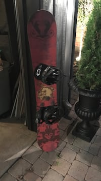 Women's Black and Pink snowboard with bindings Burlington, L7R 1B4
