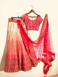 Indian Lehenga (new) Size S. Degraded fuchsia A- line Lehenga, with all over Zardozi hand beaded gold design. Paired with fuchsia net duppata with zardozi work at the border and a cap sleeve blouse with golden hand work.