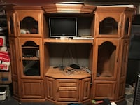 Solid oak entertainment center with lights. It fits a 32in up to a 65 in flat screen tv   Bonner Springs, 66012