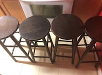 Three black wooden bar stools