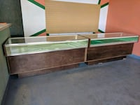 brown and green wooden bed frame Albuquerque, 87105