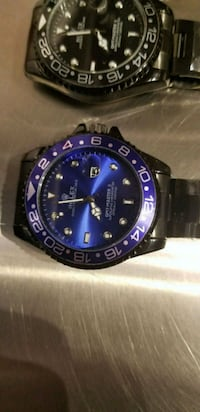 round blue and black analog watch with black strap Toronto, M6K 3S2