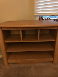 Brown wooden 3-shelf tv console 129 mi
