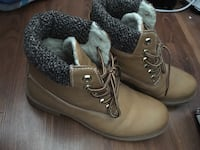 pair of brown leather work boots 732 km
