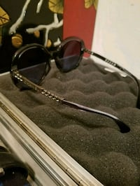 black framed sunglasses with brown lens 3490 km
