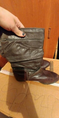 pair of black leather boots Winnipeg