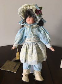 blue and white dressed porcelain doll
