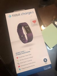 Fitbit charge 2 activity tracked +heart rate. Small (purple).