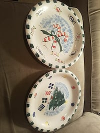 two christmas themed ceramic plates