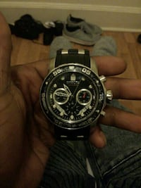 round black chronograph watch with black link brac Baltimore, 21216
