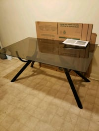 Black dinning room table with glass top Randallstown, 21133