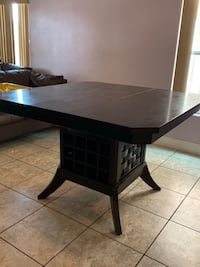 Wooden table with wine rack underneath or u can use for table settings Las Vegas, 89122