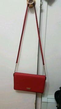 red and brown leather crossbody bag Ottawa, K2P 1B9