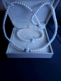 silver-colored necklace with box 3153 km
