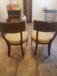 two brown wooden accent chairs  WASHINGTON