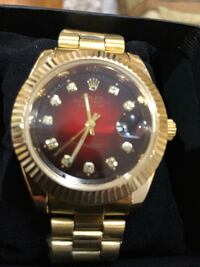 round gold-colored Rolex analog watch with link bracelet Niagara Falls, L2H 2Y7