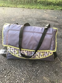 purple and black duffel bag