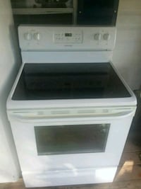 white and black induction range oven 63 km