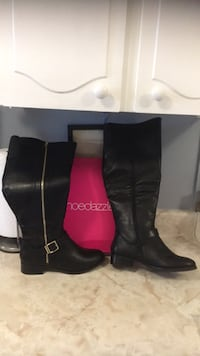 pair of black leather boots Toronto, M2J 1Z3