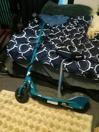 teal and gray sit and stand kickscooter