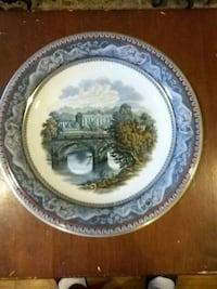 body of water under a bride with a view of trees and castle painted ceramic decorative plate 48 km