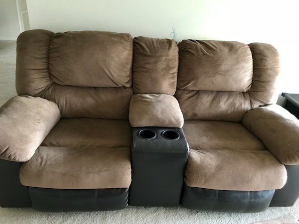 Reclining Sofa set, they are a shade of brown with suede fabric. Love seat accompanied. Well the love seat recliners are Manual but the three seater is power!