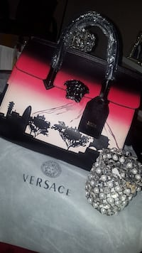 black, pink and white Versace hand bag