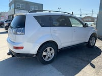 2009 Mitsubishi Outlander 4cylinder all brake and rotors are new running perfect certified 5500 plus hst Toronto