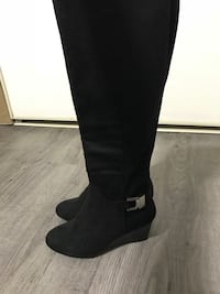 pair of black suede knee-high boots Edmonton, T6H 4T4