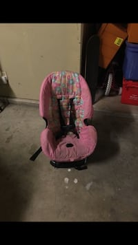 baby's pink and black car seat