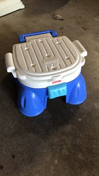 blue and white Fisher-Price potty trainer