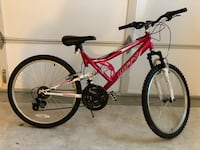red and white full suspension mountain bike