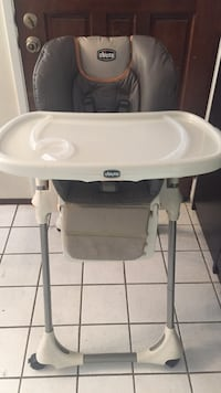 Baby's gray and white Chicco high chair