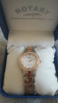 round gold analog watch with link bracelet Bolton