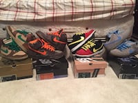 Four pairs of multicolored nike low-top sneakers with boxes