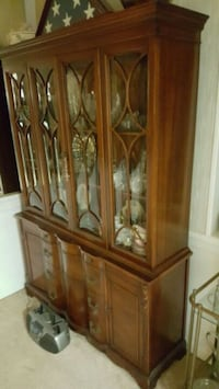 brown wooden framed glass display cabinet Washington, 20011