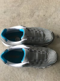 pair of gray-and-blue Nike running shoes Surrey