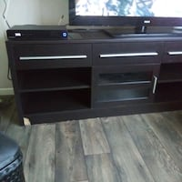TV stand only,wood chipped off bottom left corner Las Vegas, 89110