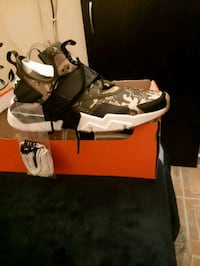 pair of white-and-black Air Jordan shoes Toronto, M6A 2Y3