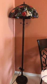 black base and red tiffany lampshade floor lamp