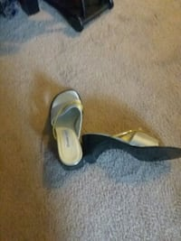 pair of black leather sandals 129 mi